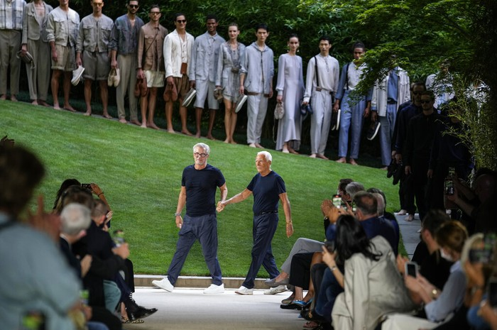 Models wear creations as part of the Giorgio Armani mens Spring Summer 2022 collection, in Milan, Italy, Monday, June 21, 2021. (AP Photo/Luca Bruno)