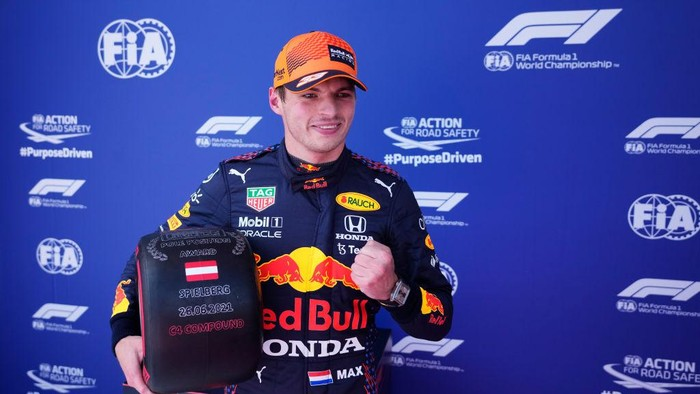 SPIELBERG, AUSTRIA - JUNE 26: Pole position qualifier Max Verstappen of Netherlands and Red Bull Racing celebrates in parc ferme during qualifying ahead of the F1 Grand Prix of Styria at Red Bull Ring on June 26, 2021 in Spielberg, Austria. (Photo by Darko Vojinovic - Pool/Getty Images)