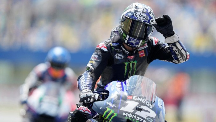 Yamaha rider Maverick Vinales of Spain waves after the MotoGP race at the Dutch Grand Prix in Assen, northern Netherlands, Sunday, June 27, 2021. (AP Photo/Peter Dejong)