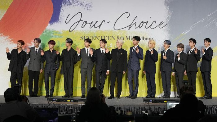 Members of South Korean K-Pop group Seventeen pose for photographers ahead of a press conference to introduce their new mini album titled