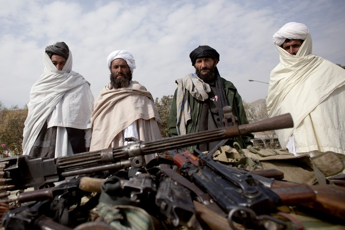 HERAT, AFGHANISTAN - OCTOBER 14:  Taliban fighters lay down their weapons as they surrender to the government of Herat Province on October 14, 2009 in Western Afghanistan.  More than 40 insurgents handed in their weapons in the wake of an ongoing government security operation which killed the Taliban commander in the Gazara district, Ghulam Yahya Akbari days ago.  (Photo by Majid/Getty Images)