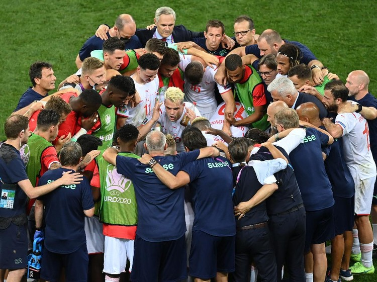 BUCHAREST, ROMANIA - JUNE 28: Granit Xhaka of Switzerland encourages the team before the penalty shoot out in the UEFA Euro 2020 Championship Round of 16 match between France and Switzerland at National Arena on June 28, 2021 in Bucharest, Romania. (Photo by Mihai Barbu - Pool/Getty Images)