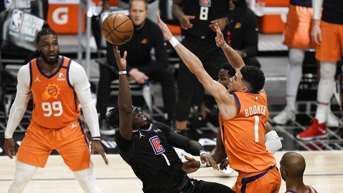 Phoenix Suns Chris Paul hoists the trophy as he and his teammates celebrate after defeating the Los Angeles Clippers in Game 6 of the NBA basketball Western Conference Finals Wednesday, June 30, 2021, in Los Angeles. (AP Photo/Jae C. Hong)