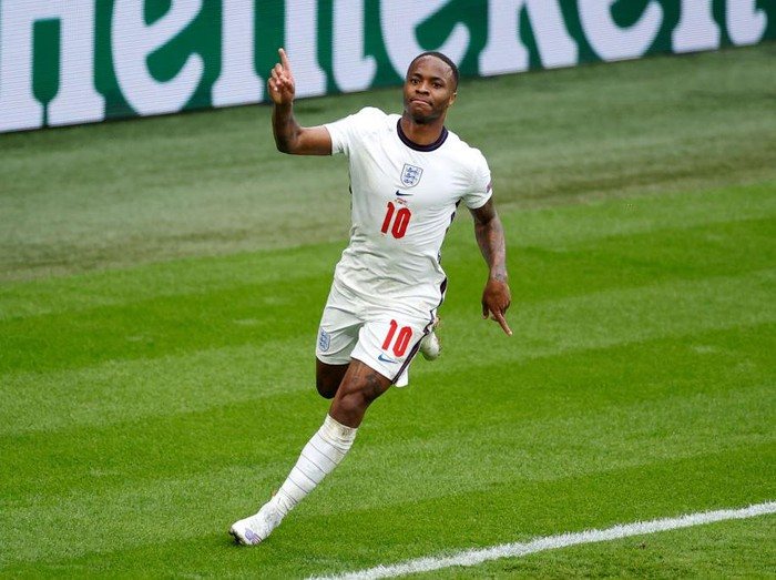 LONDON, ENGLAND - JUNE 29: Raheem Sterling of England celebrates after scoring their sides first goal during the UEFA Euro 2020 Championship Round of 16 match between England and Germany at Wembley Stadium on June 29, 2021 in London, England. (Photo by John Sibley - Pool/Getty Images)