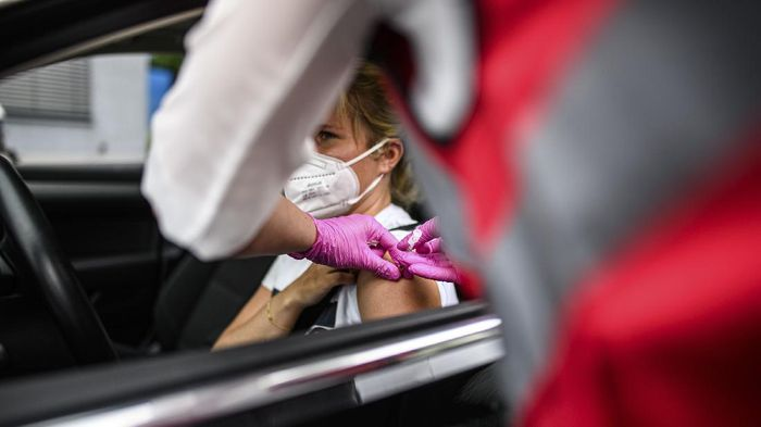 MEERBUSCH, GERMANY - JUNE 05: A doctor inoculates a local woman in a car with the Johnson and Johnson Janssen vaccine against Covid-19 at a special drive-in vaccination event on June 05, 2021 in Meerbusch, Germany. A local medical practice organized the vaccinations and is offering 3,000 doses of the vaccine to local residents today. Germany is making strong progress in its vaccination program, with approximately 45% of the population having received a first dose. (Photo by Lukas Schulze/Getty Images)
