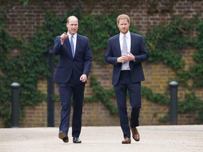 LONDON, ENGLAND - JULY 01: Prince Harry, Duke of Sussex and Prince William, Duke of Cambridge speak with garden designer Pip Morrison, during the unveiling of a statue they commissioned of their mother Diana, Princess of Wales, in the Sunken Garden at Kensington Palace, on what would have been her 60th birthday on July 1, 2021 in London, England. Today would have been the 60th birthday of Princess Diana, who died in 1997. At a ceremony here today, her sons Prince William and Prince Harry, the Duke of Cambridge and the Duke of Sussex respectively, will unveil a statue in her memory. (Photo by Dominic Lipinski - WPA Pool/Getty Images)