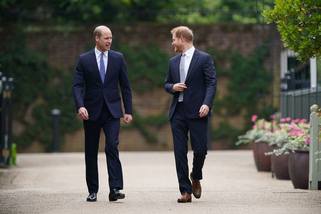 LONDON, ENGLAND - JULY 01: Prince William, Duke of Cambridge (left) and Prince Harry, Duke of Sussex unveil a statue they commissioned of their mother Diana, Princess of Wales, in the Sunken Garden at Kensington Palace, on what would have been her 60th birthday on July 1, 2021 in London, England. Today would have been the 60th birthday of Princess Diana, who died in 1997. At a ceremony here today, her sons Prince William and Prince Harry, the Duke of Cambridge and the Duke of Sussex respectively, will unveil a statue in her memory. (Photo by Dominic Lipinski - WPA Pool/Getty Images)