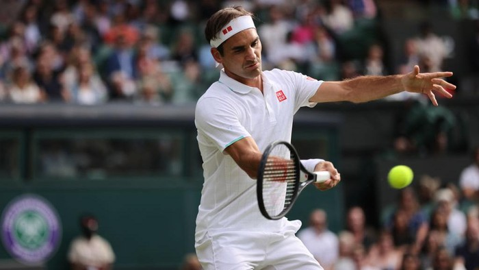 LONDON, ENGLAND - JULY 01: Roger Federer of Switzerland plays a forehand during his mens singles second round match against Richard Gasquet of France during Day Four of The Championships - Wimbledon 2021 at All England Lawn Tennis and Croquet Club on July 01, 2021 in London, England. (Photo by Clive Brunskill/Getty Images)