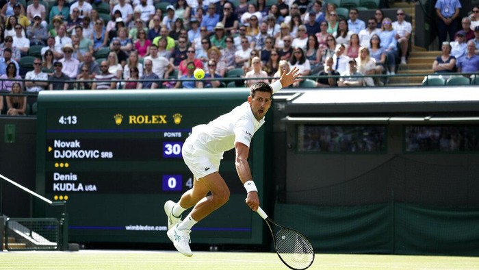 Serbias Novak Djokovic plays a return to Denis Kudla of the US during the mens singles third round match on day five of the Wimbledon Tennis Championships in London, Friday July 2, 2021. (AP Photo/Alberto Pezzali)