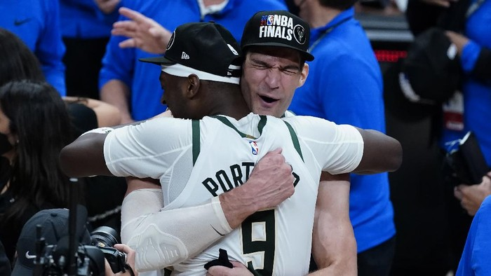 Milwaukee Bucks Brook Lopez, right, hugs Bobby Portis after defeating the Atlanta Hawks in Game 6 of the Eastern Conference finals in the NBA basketball playoffs and advancing to the NBA Championship, Saturday, July 3, 2021, in Atlanta. (AP Photo/John Bazemore)