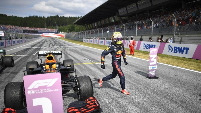 Red Bull driver Max Verstappen of the Netherlands, left, steers his car during the Austrian Formula One Grand Prix at the Red Bull Ring racetrack in Spielberg, Austria, Sunday, July 4, 2021. (AP Photo/Darko Bandic)