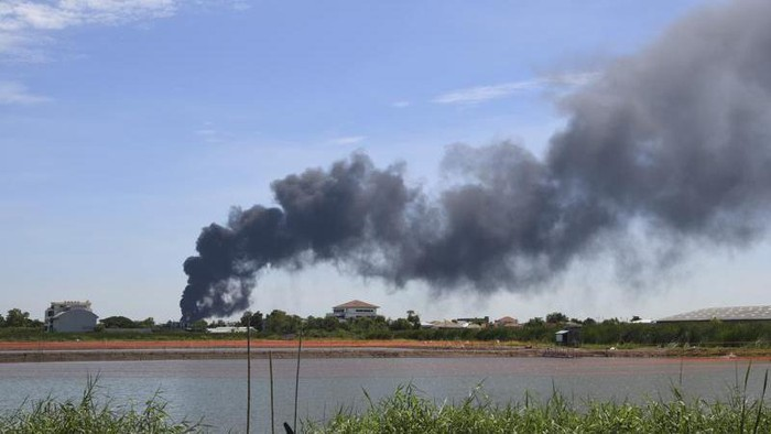 Smoke rises into the air from a factory in Samut Prakan province, Thailand, Monday, July 5, 2021. A massive explosion at the factory on the outskirts of Bangkok early Monday shook an airport terminal serving Thailands capital and prompted the evacuation of residents from the area. (AP Photo)