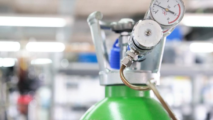 Gas cylinders with pressure gauge in a specialized laboratory. Laboratory material.