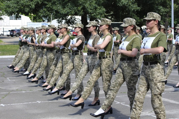 """In this photo taken and released by the Ukrainian Defense ministry press-service on July 2, 2021, Ukrainian female soldiers wear heels while taking part in the the military parade rehearsal in Kyiv, Ukraine. Ukraines defense minister is under pressure from members of the government over the decision to have female military cadets wear mid-heeled pumps in a parade. A joint statement from three Cabinet members, including Minister of Veterans Affairs Yulia Laputina, said """"the purpose of any military parade is to demonstrate the military ability of the army. (Ukrainian Defense Ministry Press Office via AP)"""
