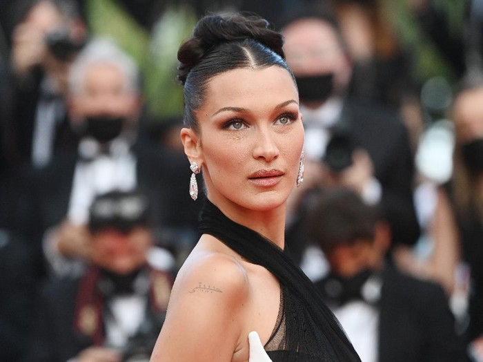 CANNES, FRANCE - JULY 06: Bella Hadid and Carla Bruni attend the