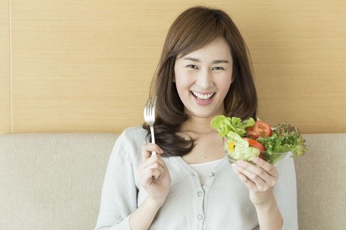 [size=12]Asian woman is happy holding salad and a fork in her hand [/size]  [url=http://www.istockphoto.com/search/portfolio/7795483/?facets=%7B%2225%22%3A%226%22%7D#fef7e09][img]http://goo.gl/JLoF3[/img][/url]