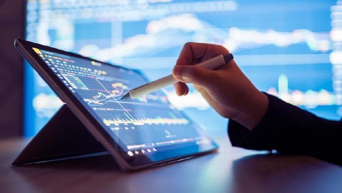 Woman looking stock market Data on smart phone