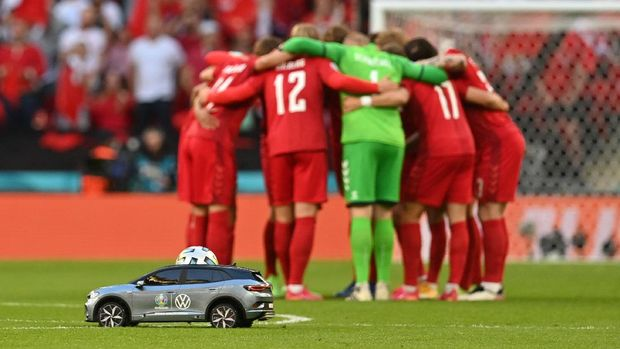 LONDON, ENGLAND - JULY 07: A detailed view of the Adidas Uniforia match ball is seen in the Volkswagen Remote Control Mini Car as it is delivered on to the pitch whilst the players of Denmark form a huddle prior to the UEFA Euro 2020 Championship Semi-final match between England and Denmark at Wembley Stadium on July 07, 2021 in London, England. (Photo by Paul Ellis - Pool/Getty Images)