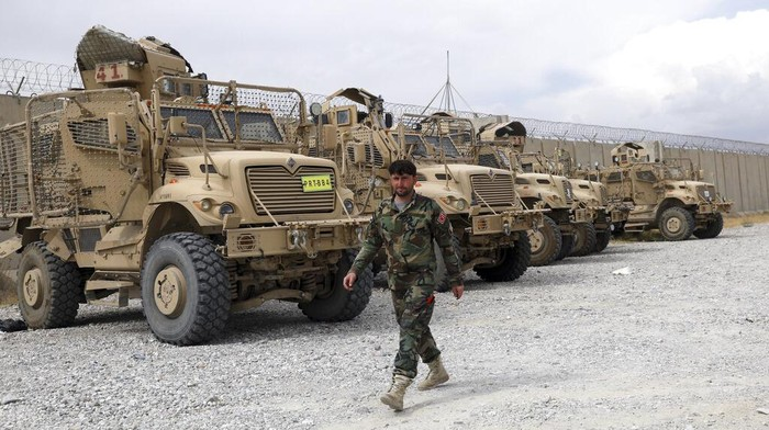 A member of the Afghan security forces stands guard after the American military left Bagram air base, in Parwan province north of Kabul, Afghanistan, Monday, July 5, 2021. The U.S. left Afghanistans Bagram Airfield after nearly 20 years, winding up its