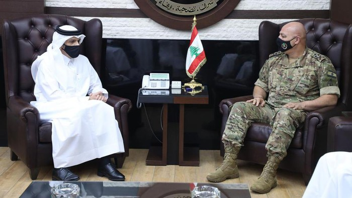 In this photo released by the Lebanese Army official website, Lebanese Army Commander Gen. Joseph Aoun, right, meets with Qatars Deputy Prime Minister and Foreign Minister Sheikh Mohammed bin Abdulrahman bin Jassim Al-Thani, at the defense ministry, in Beirut, Lebanon, Tuesday, July 6, 2021. Qatars Foreign Minster is in Beirut for one day visit to meet with Lebanese officials. (Lebanese Army Website via AP)