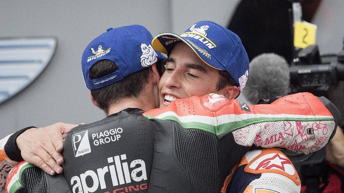HOHENSTEIN-ERNSTTHAL, GERMANY - JUNE 20:  Marc Marquez of Spain and Repsol Honda Team celebrates with Aleix Espargaro of Spain and Aprilia Racing Team Gresini (L) under the podium during the MotoGP race during the MotoGP of Germany - Race at Sachsenring Circuit on June 20, 2021 in Hohenstein-Ernstthal, Germany. (Photo by Mirco Lazzari gp/Getty Images)