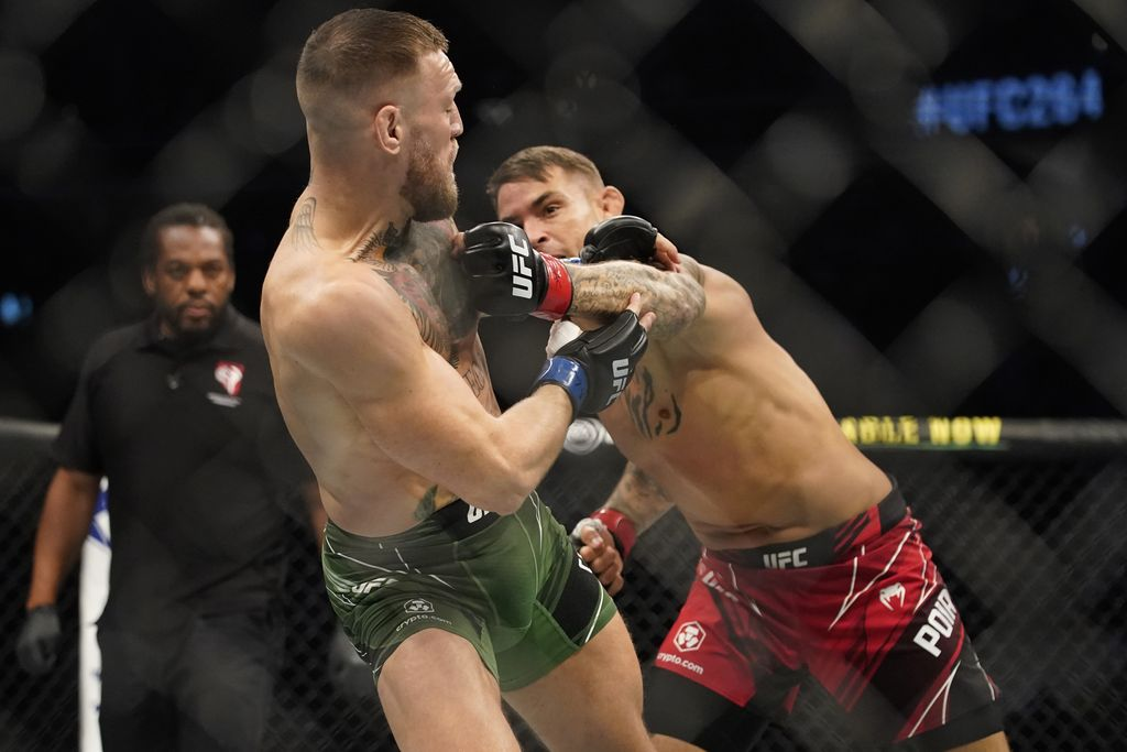 Conor McGregor, left, tries to avoid a punch from Dustin Poirier during a UFC 264 lightweight mixed martial arts bout Saturday, July 10, 2021, in Las Vegas. (AP Photo/John Locher)