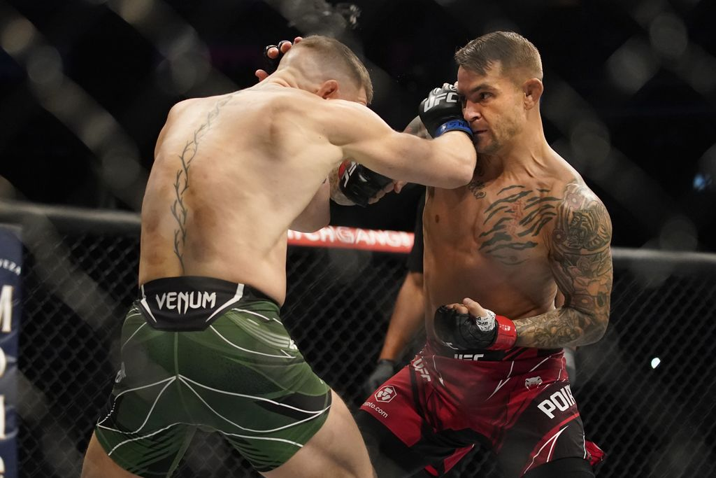 Conor McGregor, left, fights Dustin Poirier during a UFC 264 lightweight mixed martial arts bout Saturday, July 10, 2021, in Las Vegas. (AP Photo/John Locher)