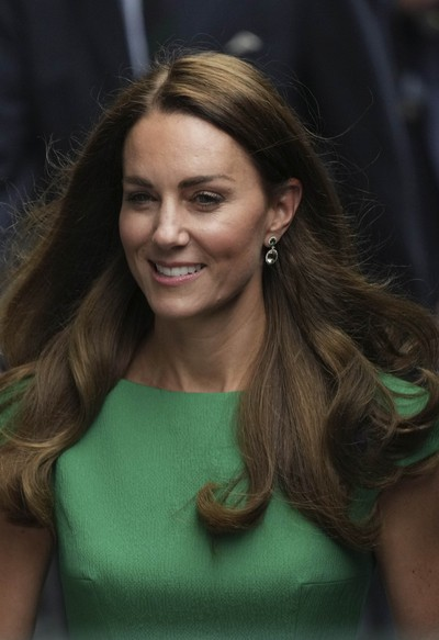 Kate, Duchess of Cambridge, walks for the presentation ceremony for the womens singles on day twelve of the Wimbledon Tennis Championships in London, Saturday, July 10, 2021. (AP Photo/Alberto Pezzali)