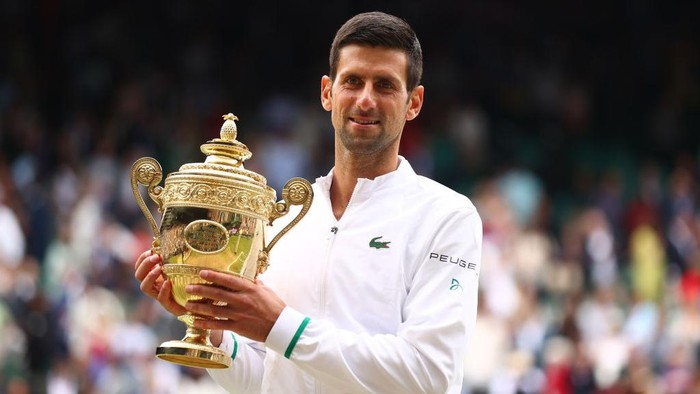 LONDON, ENGLAND - JULY 11: Novak Djokovic of Serbia celebrates with the trophy after winning his mens Singles Final match against Matteo Berrettini of Italy on Day Thirteen of The Championships - Wimbledon 2021 at All England Lawn Tennis and Croquet Club on July 11, 2021 in London, England. (Photo by Julian Finney/Getty Images)