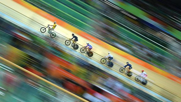 Olimpiade tak hanya ditunggu para Atlet, fotografer pun menunggu ajang ini untuk abadikan momen yang memukau mata. Berikut beragam foto memukau di Olimpiade Rio