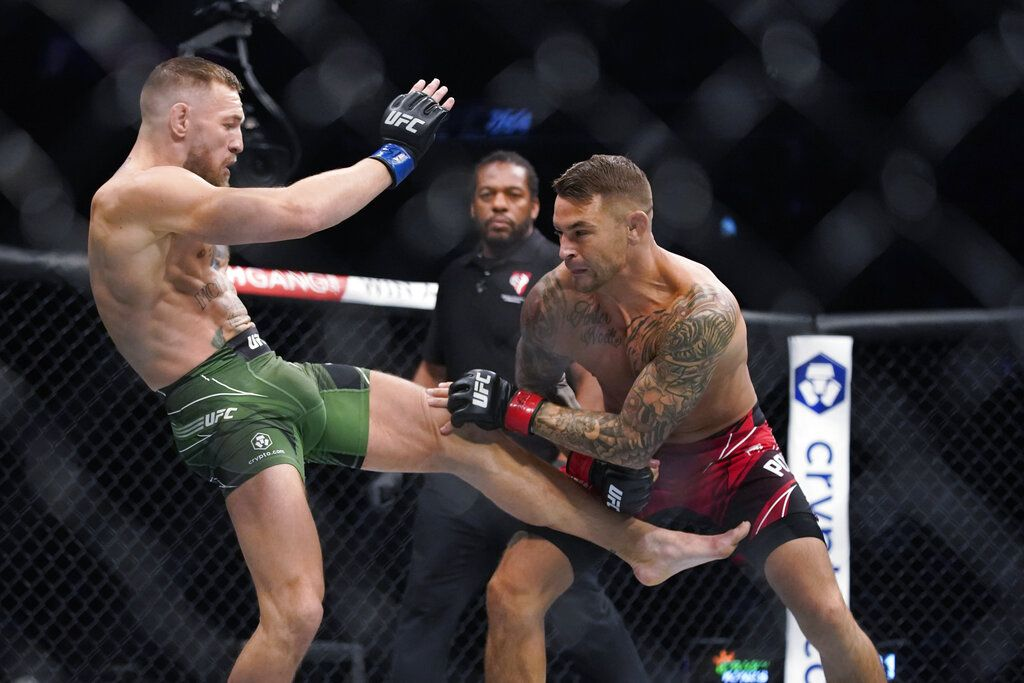Conor McGregor, left, faces Dustin Poirier in a UFC 264 lightweight mixed martial arts bout Saturday, July 10, 2021, in Las Vegas. (AP Photo/John Locher)