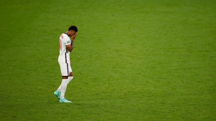 LONDON, ENGLAND - JULY 11: Marcus Rashford of England reacts after missing their teams third penalty in the penalty shoot out during the UEFA Euro 2020 Championship Final between Italy and England at Wembley Stadium on July 11, 2021 in London, England. (Photo by John Sibley - Pool/Getty Images)