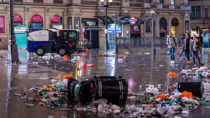 LONDON, ENGLAND - JULY 12: A street cleaner sweeps up rubbish at Leicester Square on July 12, 2021 in London, England. Italy's men's team claimed victory over England in the UEFA EURO 2020 final at Wembley Stadium, winning the tournament for the first time since they hosted the competition in 1968. (Photo by HGL/Getty Images)
