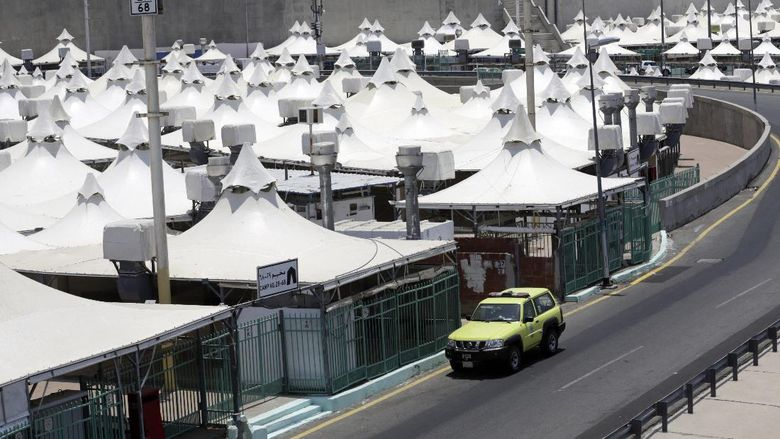 A police vehicle patrols a tent camp in Mina, near the Muslim holy city of Mecca, ahead of the upcoming annual hajj pilgrimage, Monday, July 12, 2021. The pilgrimage to Mecca required once in a lifetime of every Muslim who can afford it and is physically able to make it, used to draw more than 2 million people. But for a second straight year it has been curtailed due to the coronavirus with only vaccinated people in Saudi Arabia able to participate. (AP Photo/Amr Nabil)