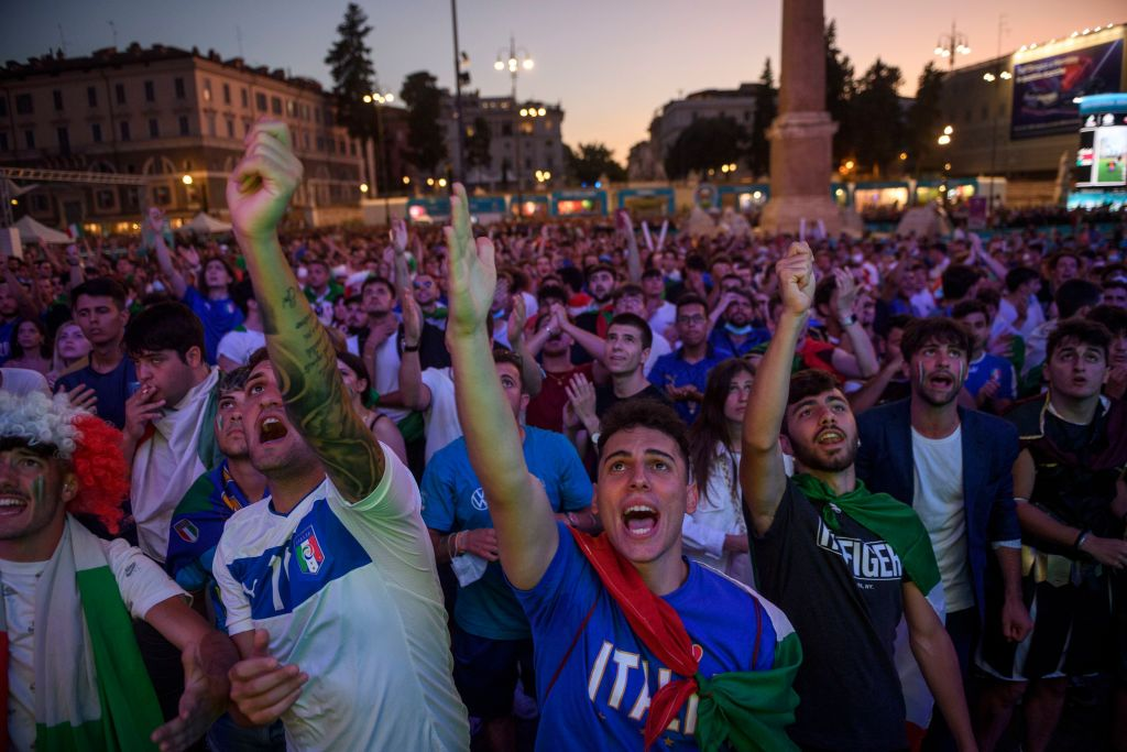 ROME, ITALY - JULY 11: Italian fans watch on giant screens at Piazza del Popolo fan zone the Euro 2020 Final match between Italy and England, played at Wembley stadium, on July 11, 2021 in Rome, Italy. Italy's national football team remain unbeaten in their last 33 games and meet England, playing in their first major final for 55 years, in the European Championships Final. The tournament was postponed from last year due to the Covid-19 pandemic. (Photo by Antonio Masiello/Getty Images)