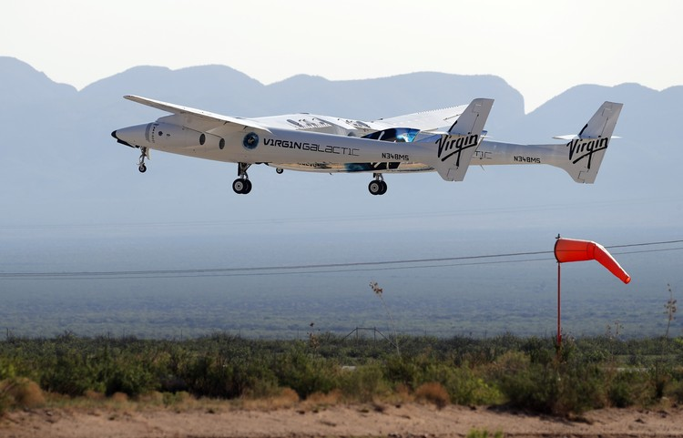 Special guests chat as they wait for Virgin Galactic founder Richard Bransons launch to space aboard his own rocket ship near Truth or Consequences, New Mexico, Sunday, July 11, 2021. (AP Photo/Andres Leighton)