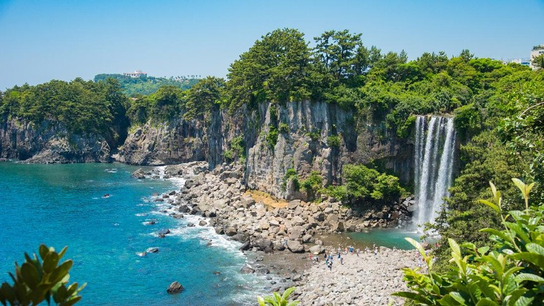 The Jeongbang Waterfall which falls directly into the sea, Jeju-do, South Korea