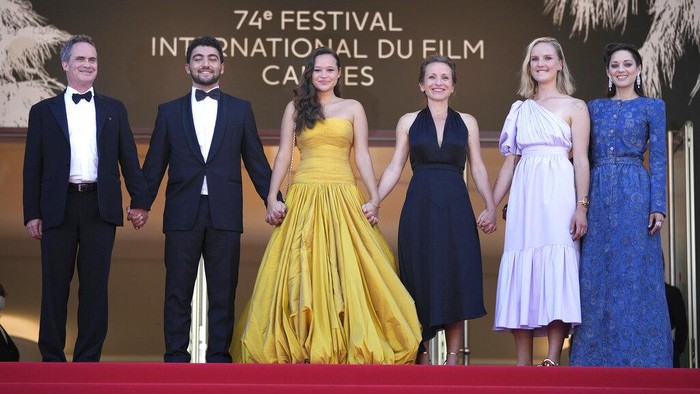 Mary Finn, from left, Marion Cotillard, Melati Wijsen, and Mohamad Al Jounde pose for photographers at the photo call for the film 'Bigger Than Us' at the 74th international film festival, Cannes, southern France, Saturday, July 10, 2021. (Photo by Vianney Le Caer/Invision/AP)