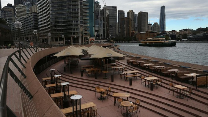 SYDNEY, AUSTRALIA - JUNE 24:  The Opera House cafe area and surrounds are seen empty of people at Circular Quay on June 24, 2021 in Sydney, Australia. A steady increase in Covid-19 cases in Sydney prompted the government to impose greater restrictions including a mandatory mask mandate indoors and limits on gatherings and movement. Several Sydney suburbs have been declared federal Covid-19 hotspots. (Photo by Lisa Maree Williams/Getty Images)