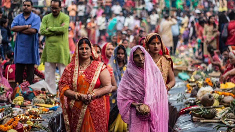 New Delhi, Delhi/ India- November 02 2019 : Women of India celebrating Chhath Pooja by drowning themselves in Water for praying to sun.