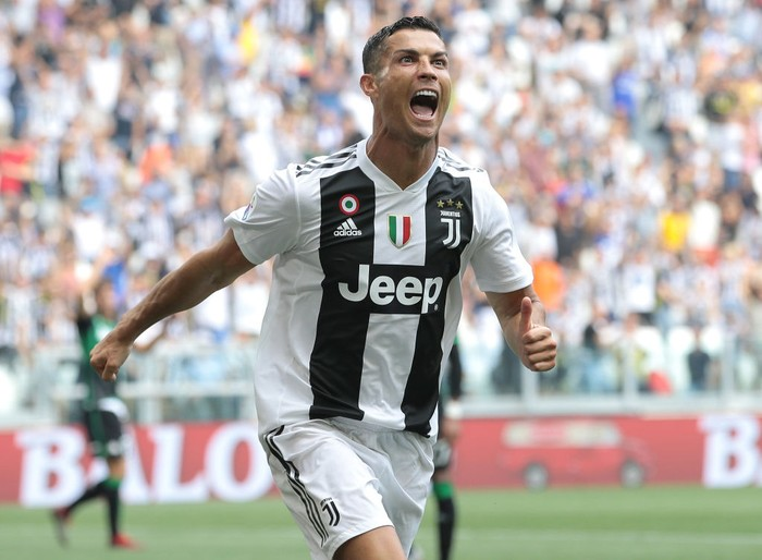 TURIN, ITALY - SEPTEMBER 16:  Cristiano Ronaldo of Juventus FC celebrates after scoring the opening goal during the serie A match between Juventus and US Sassuolo at Allianz Stadium on September 16, 2018 in Turin, Italy.  (Photo by Emilio Andreoli/Getty Images)