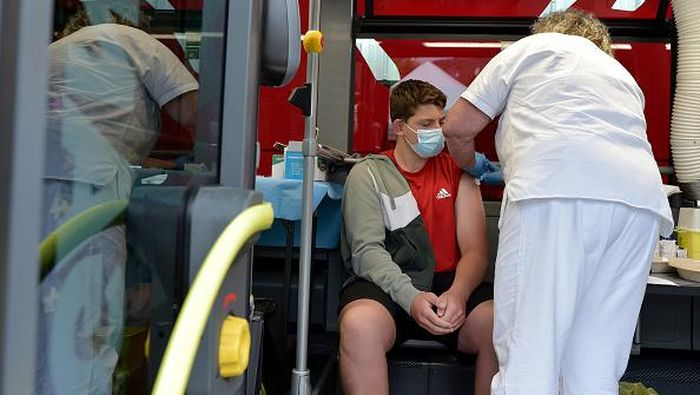 BOLZANO, ITALY - JULY 14: People receive their Covid-19 vaccine in one of two SASA buses equipped as vaccination centers, operating in the small towns of South Tyrol, on July 14, 2021 in Bolzano, Italy. Italy has administered some 58,213,710 doses of Covid vaccines to the population, accounting for 48.3% of the countrys population. Covid-19 infections are increasing in Italy, with 1,195 new infections reported on average each day.  (Photo by Alessio Coser/Getty Images)