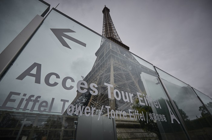 PARIS, FRANCE - JULY 16: Visitors walk down from the top of the Eiffel Tower as the iconic landmark reopened for the first time in over 8 months on July 16, 2021 in Paris, France. The iconic Paris landmark has been closed since October 30th, 2020, due to the Coronavirus Pandemic restrictions, its longest closure since WWII. (Photo by Kiran Ridley/Getty Images)