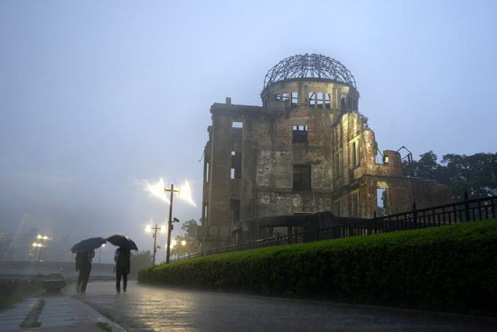 A man walks near the Atomic Bomb Dome Friday, July 16, 2021, in Hiroshima, western Japan. Japan will mark the 76th anniversary of the atomic bombing on Hiroshima on Aug. 6. (c)