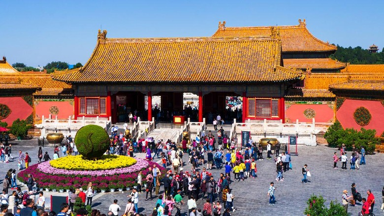 Beijing, China - September 29, 2018: Tourists entering Forbidden city imperial palace complex in central Beijing, China on a sunny day