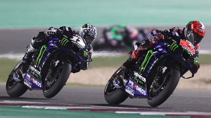 Monster Energy Yamaha MotoGPs French rider Fabio Quartararo (R) and Monster Energy Yamaha MotoGPs Spanish rider Maverick Vinales drive during the Moto GP Grand Prix of Doha at the Losail International Circuit, in the city of Lusail on April 4, 2021. (Photo by KARIM JAAFAR / AFP)