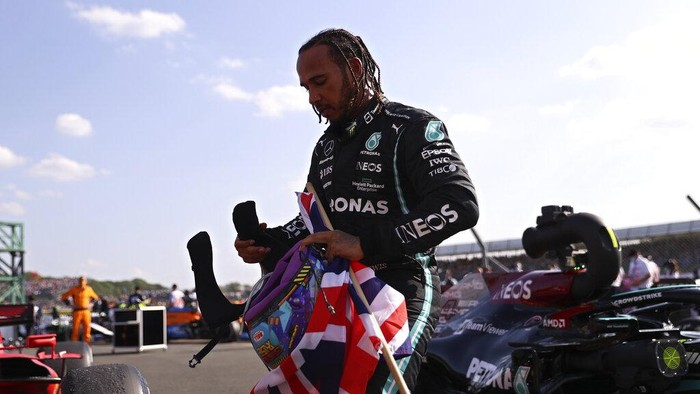 Mercedes driver Lewis Hamilton of Britain gets out of his car after winning the British Formula One Grand Prix, at the Silverstone circuit, in Silverstone, England, Sunday, July 18, 2021. (Lars Baron/Pool photo via AP)
