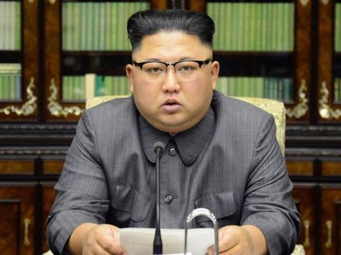 Di sini tak ada gaya rambut seperti milik Korea Selatan, kata Kim Jong-un (AFP via Getty Images)