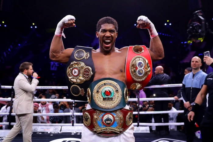 DIRIYAH, SAUDI ARABIA - DECEMBER 07: Anthony Joshua poses for a photo with the IBF, WBA, WBO & IBO World Heavyweight Title belts after the IBF, WBA, WBO & IBO World Heavyweight Title Fight between Andy Ruiz Jr and Anthony Joshua during the Matchroom Boxing Clash on the Dunes show at the Diriyah Season on December 07, 2019 in Diriyah, Saudi Arabia (Photo by Richard Heathcote/Getty Images)