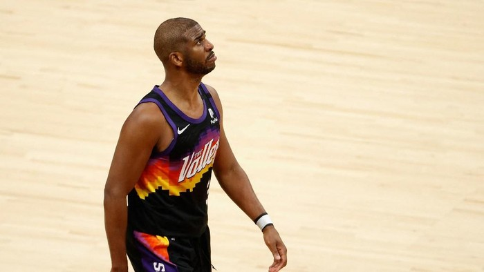 PHOENIX, ARIZONA - JULY 17: Chris Paul #3 of the Phoenix Suns reacts in the second half of game five of the NBA Finals against the Milwaukee Bucks at Footprint Center on July 17, 2021 in Phoenix, Arizona. The Bucks defeated the Suns 123-119. NOTE TO USER: User expressly acknowledges and agrees that, by downloading and or using this photograph, User is consenting to the terms and conditions of the Getty Images License Agreement.   Christian Petersen/Getty Images/AFP (Photo by Christian Petersen / GETTY IMAGES NORTH AMERICA / Getty Images via AFP)